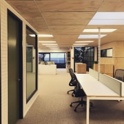 The desk system is ideal for open offices architecture, ceiling, floor, flooring, interior design, office, real estate, orange, brown