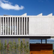 Concrete 'bars' give this part of the home architecture, building, elevation, facade, home, house, real estate, residential area, white, blue