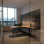 The desk system can be tailored for any architecture, floor, flooring, furniture, glass, interior design, real estate, brown, gray, black