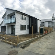 How to reap rewards from your under-utilised section building, facade, home, house, neighbourhood, property, real estate, residential area, siding, white, gray