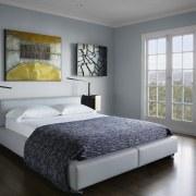 For this master suite by interior designer Jiun bed, bed frame, bed sheet, bedroom, floor, furniture, home, interior design, mattress, room, wall, gray, black
