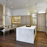 The kitchen sits off to one side of ceiling, countertop, floor, flooring, interior design, kitchen, wood flooring, gray