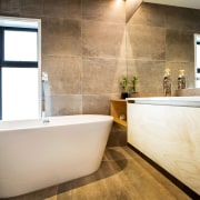 Large floor and wall tiles were specified in bathroom, floor, flooring, home, interior design, room, tile, wall, white