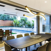 Perimeter planting defines this rear outdoor living space, ceiling, dining room, interior design, real estate, table, window, white