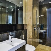 Natural stone is a feature of this ground architecture, bathroom, countertop, floor, interior design, room, sink, tile, black, gray