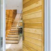 A timber front door provides an early touch architecture, door, home, interior design, property, real estate, wall, window, wood, orange, white, gray