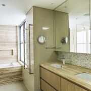The ensuite cabinetry in this master suite continues architecture, bathroom, floor, home, interior design, room, sink, white, brown