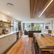 This sustainability-conscious home renovation by designer Jason Higham ceiling, countertop, floor, flooring, hardwood, house, interior design, kitchen, real estate, room, wood, wood flooring, brown, gray