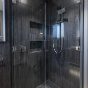 Custom shower doors tuck back for more floor bathroom, door, floor, flooring, glass, interior design, plumbing fixture, room, shower, tile, black, gray