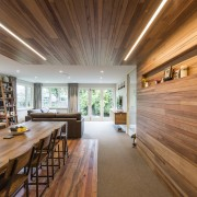 As part of this renovation of a 1950s architecture, ceiling, daylighting, estate, flooring, hardwood, home, house, interior design, living room, real estate, wood, wood flooring, brown