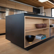 Sleek new kitchen has both a clean-lined design cabinetry, floor, furniture, interior design, shelving, table, wood, brown