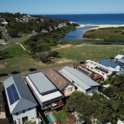 Roar Northcurlcurl House 05S aerial photography, bird's eye view, energy, home, house, photography, real estate, roof, sea, sky, water, brown