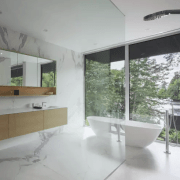 Full-height glazing in this contemporary master suite ensures architecture, bathroom, home, house, interior design, property, real estate, window, gray
