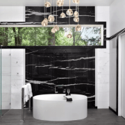 The open shower with glass walls doesn't intrude floor, flooring, interior design, living room, room, wall, gray