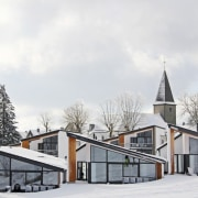 A view of the villas in winter architecture, building, facade, home, house, property, real estate, residential area, sky, snow, winter, white