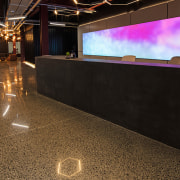 The reception at The B:HIVE acts more like floor, flooring, interior design, black, brown