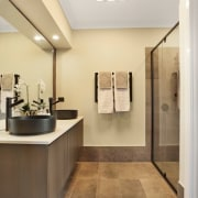 His and her sinks sit beneath a large bathroom, floor, home, interior design, product design, room, sink, gray