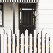 A new take on the picket fence invites facade, fence, gate, home fencing, iron, outdoor structure, picket fence, siding, structure, white
