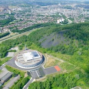 569 firestation aerial photography, bird's eye view, city, land lot, metropolitan area, sport venue, structure, suburb, water resources, green, gray