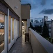 A narrow balcony provides expansive city views apartment, architecture, building, condominium, home, house, property, real estate, sky, window, black