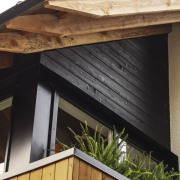 Raw timber supports add character daylighting, facade, house, roof, siding, wood, black