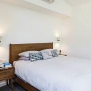 The bedroom features spacious ceilings bed, bed frame, bedroom, furniture, home, property, real estate, room, wood, white