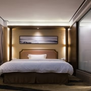 These spacious bedrooms feature numerous eastern touches bed, bed frame, bedroom, ceiling, interior design, lighting, room, suite, black, gray