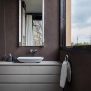 Soft maroon compliments the cabinets bathroom, bathroom accessory, bathroom cabinet, interior design, plumbing fixture, product design, room, sink, tap, black, gray