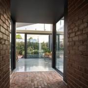 Looking through architecture, brick, daylighting, estate, floor, flooring, home, house, interior design, property, real estate, window, wood flooring, black