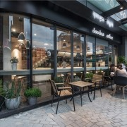 The designers intended the outside to be a café, coffeehouse, restaurant, black, gray