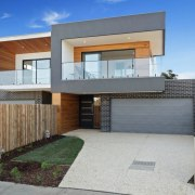 One part of the home is set back architecture, elevation, estate, facade, home, house, property, real estate, residential area, gray