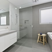 The shower links up to the rest of bathroom, bathroom accessory, floor, home, interior design, real estate, room, sink, gray