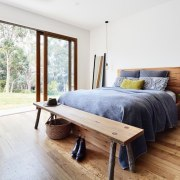 The bedroom opens right out onto the lawn architecture, bed, bed frame, bedroom, floor, flooring, furniture, hardwood, home, house, interior design, laminate flooring, real estate, wood, wood flooring, white