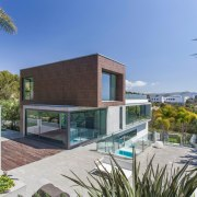 This block sits atop the main living area architecture, condominium, estate, facade, home, house, property, real estate, residential area, swimming pool, villa, gray, teal