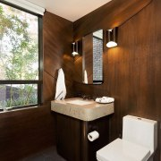 Wood panelling in the bathroom carries through from bathroom, interior design, room, brown, white