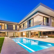Metropole Architects have recently completed a new house architecture, elevation, estate, facade, home, house, mansion, property, real estate, residential area, sky, swimming pool, villa, window