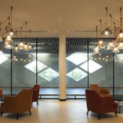 This light arrangement draws attention to the informal ceiling, furniture, interior design, light fixture, lighting, lobby, table, brown
