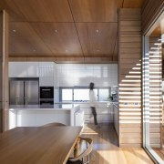 A large, spacious kitchen is sheltered from the architecture, ceiling, countertop, daylighting, house, interior design, kitchen, loft, real estate, wood, brown