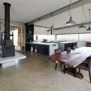 The expansive windows in the kitchen make the floor, flooring, interior design, property, real estate, gray
