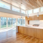 Wood runs up from the floor and into architecture, ceiling, daylighting, floor, flooring, hardwood, home, house, interior design, laminate flooring, real estate, window, wood, wood flooring, white