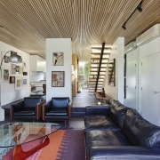The hallway (with staircase) and kitchen lead down ceiling, interior design, living room, loft, real estate, gray