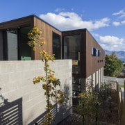 Arrowtown-based Bennie Builders was the only Southern Lakes architecture, building, facade, home, house, property, real estate, siding, gray