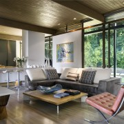 You can see elements of the Glass House house, interior design, living room, real estate, window, gray, brown