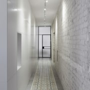 Original brick lines this wall of the hallway architecture, ceiling, daylighting, floor, interior design, gray