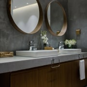 Circular mirrors above his and hers sinks add bathroom, bathroom cabinet, countertop, interior design, room, sink, tap, black, gray