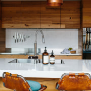 A diner-style splashback holds a magnetic knife rack countertop, cuisine classique, furniture, hardwood, interior design, kitchen, table, wood, brown