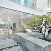 The home's internal courtyard is an ideal place apartment, architecture, condominium, courtyard, estate, home, house, interior design, property, real estate, gray