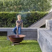 Stacked seating means entertaining is a breeze backyard, furniture, garden, grass, lawn, outdoor structure, plant, tree, water, yard, gray, green