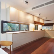 This large counter makes up for the lack architecture, house, interior design, kitchen, property, real estate, window, gray