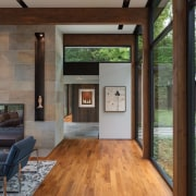 The fireplace is central in this living area architecture, floor, flooring, house, interior design, real estate, window, gray, brown